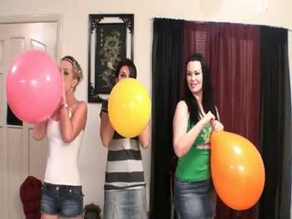THREE CHICKS BLOWING BALLOONS