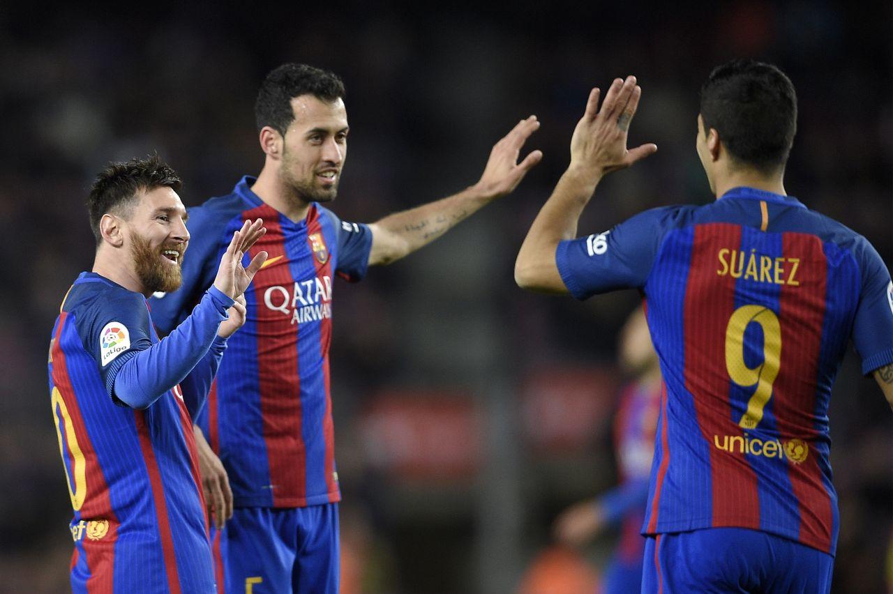 Лионель Месси, Серхио Бускетс и Луис Суарес. ФК Барселона
