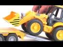 Тягач с прицепом--платформой MAN с колесным экскаватором--погрузчиком JCB 4CX от Bruder 02-776