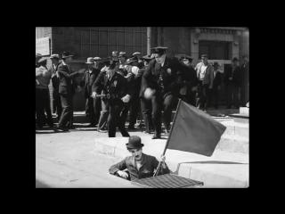 Чарли Чаплин и флаг. Из фильма Новые времена. Charlie Chaplin - Modern Times - Flag