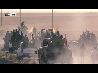 Иракские ополченцы ведут бои с террористами в ходе переброски на территорию Сир...