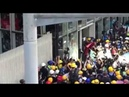 Liveleak Protesters breaking through the glass doors of the Legislative Council building