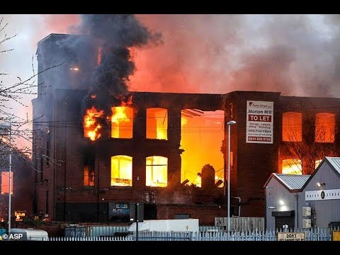 Large fire rips through former mill building in Manchester