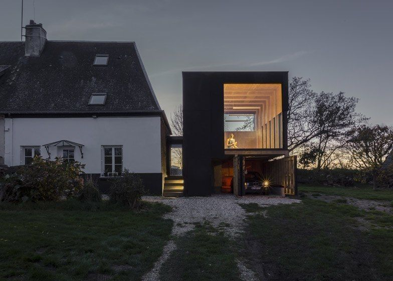 blackened plywood box added by architect Antonin Ziegler to one end of a rural home on France's northern
