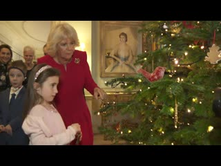 Duchess of christmas! camilla invites children into clarence house to decorate her christmas tree