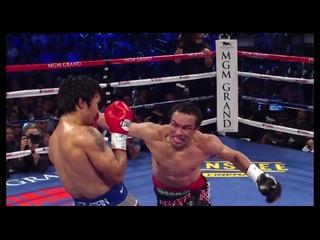 Хуан Мануэль Маркес делает ложный выпад в корпус и накрывает мощным оверхендом Мэнни Пакьяо
