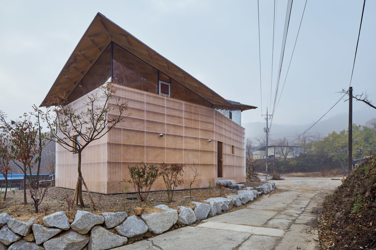 Entwined timber columns define structure of The House of Three Trees